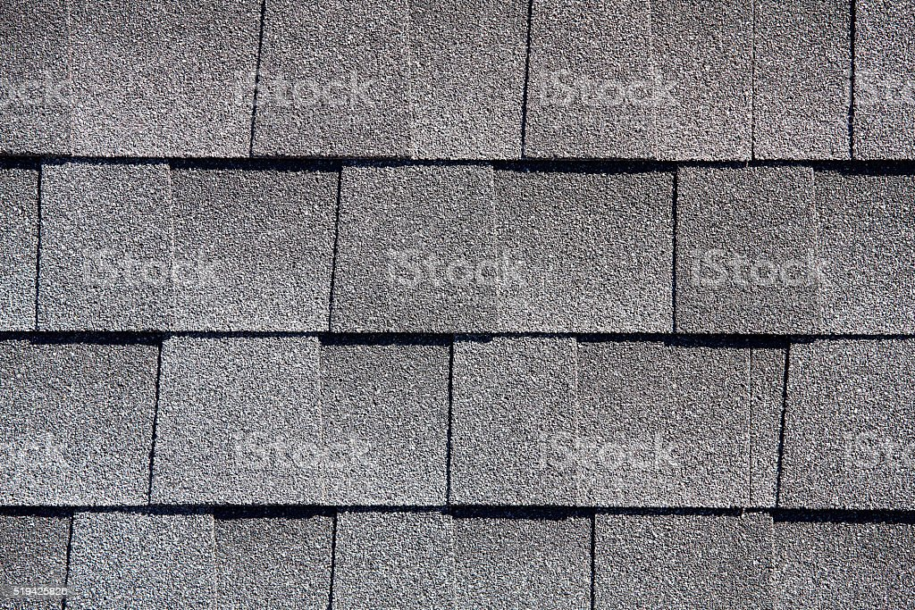 Roofing Shingles gray sand shake tab style pattern stock photo