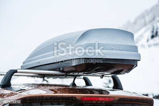 istock Roofrack with cargo box in winter 467475310