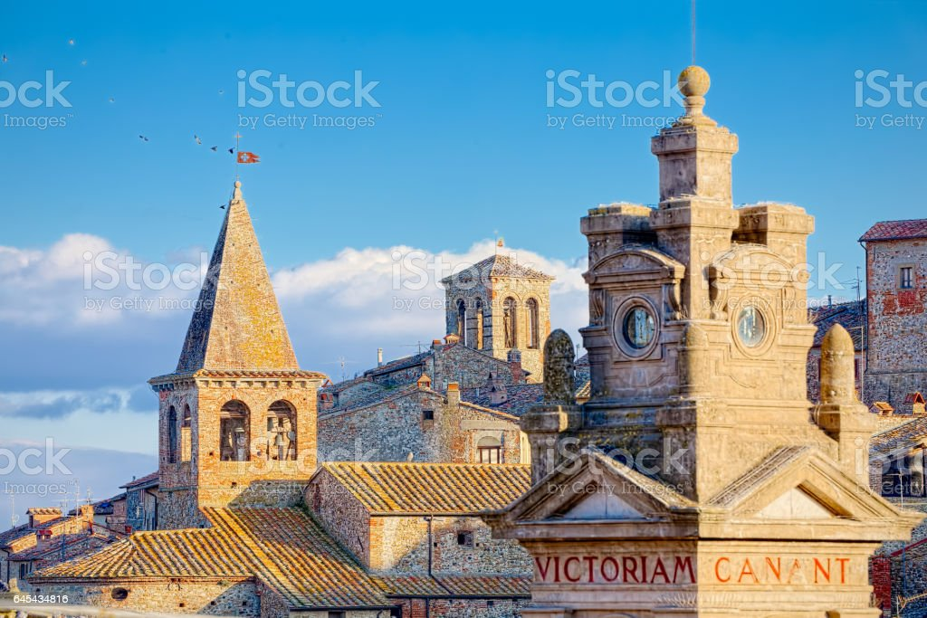 Roofs and towers of Tuscan village of Anghiari at sunset stock photo