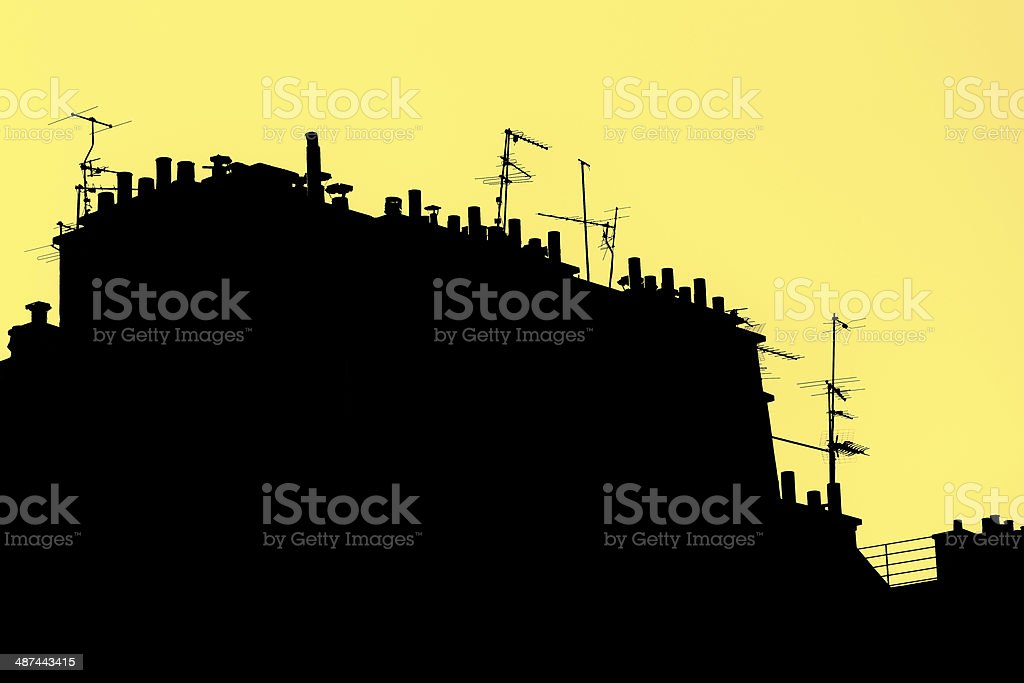 Roofs in Paris Stylized. Silhouette on Yellow Background stock photo