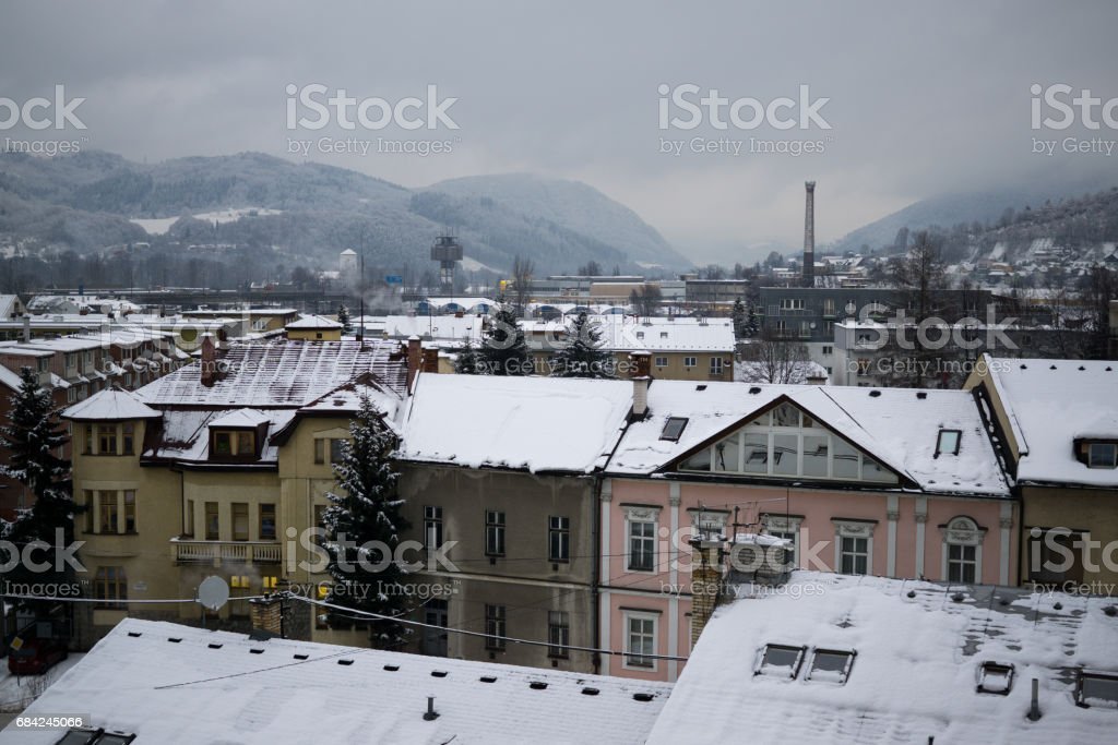 Roofs of buildings covered by snow during strong snowfall. Slovakia royalty-free stock photo