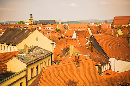 Roofs of houses in Bamberg city in bavaria. Ancient city in Germany. Medieval town. Travel around Europe. Roof tiles. Beautiful awesome summer landscape. Buildings and architecture in Bamberg.