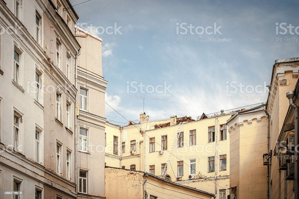 Roofs of the houses in Moscow courtyard under the blue sky stock photo