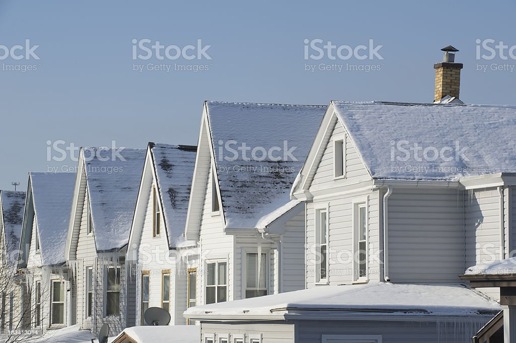 Roofs Under Snow, Houses in Winter Dawn Light stock photo