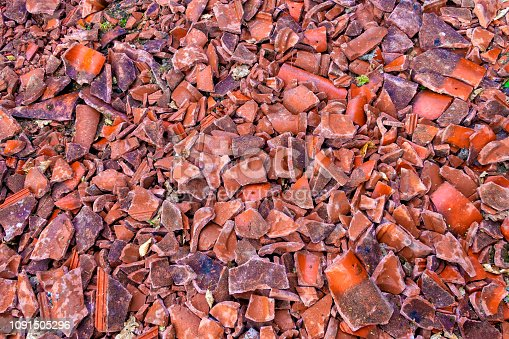 Broken rooftiles spread out on ground