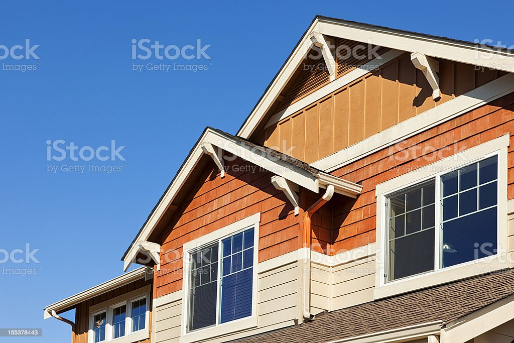 Rooftop Against Clear Blue Sky Photograph of a new house rooftop against a clear blue sky. Architecture Stock Photo
