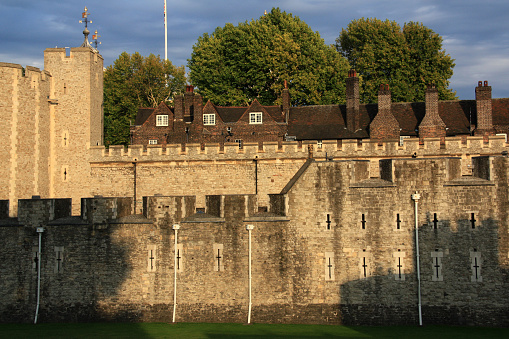 Rooftop and Chimneys of the Queen's House behind the fortified wall of Her Majesty's Royal Palace and Fortress of the Tower of London, United Kingdom