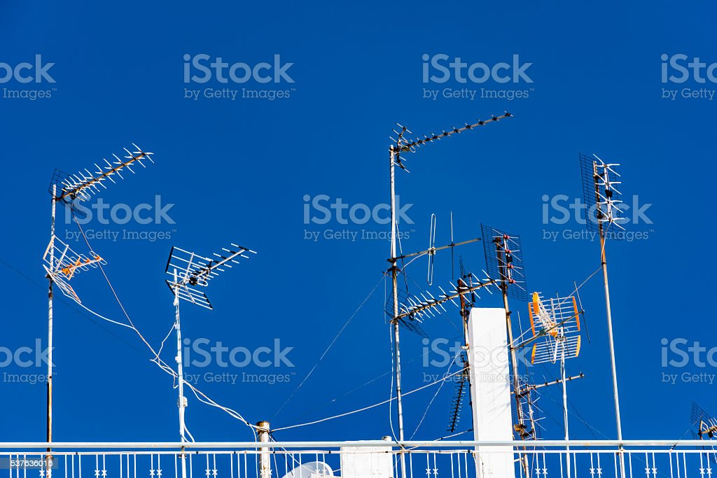 Rooftop antennas against a blue sky #2 stock photo