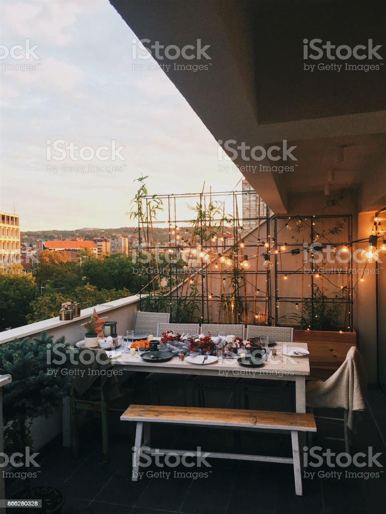 Rooftop dinner party table set up stock photo