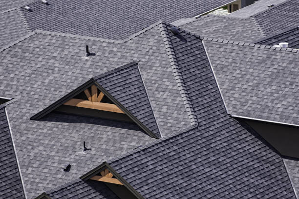 Rooftop in a newly constructed subdivision showing asphalt shingles stock photo