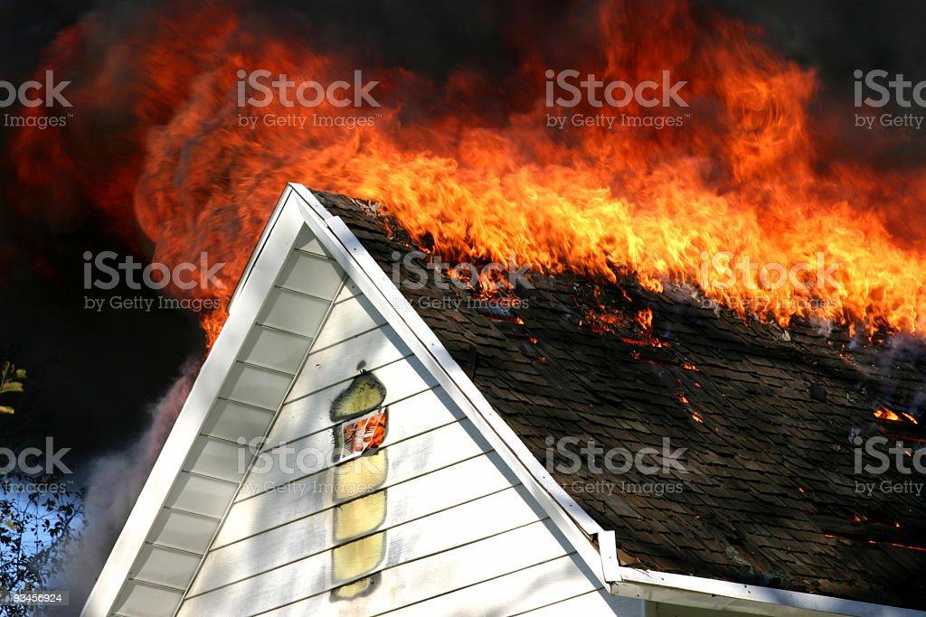 Rooftop on fire stock photo