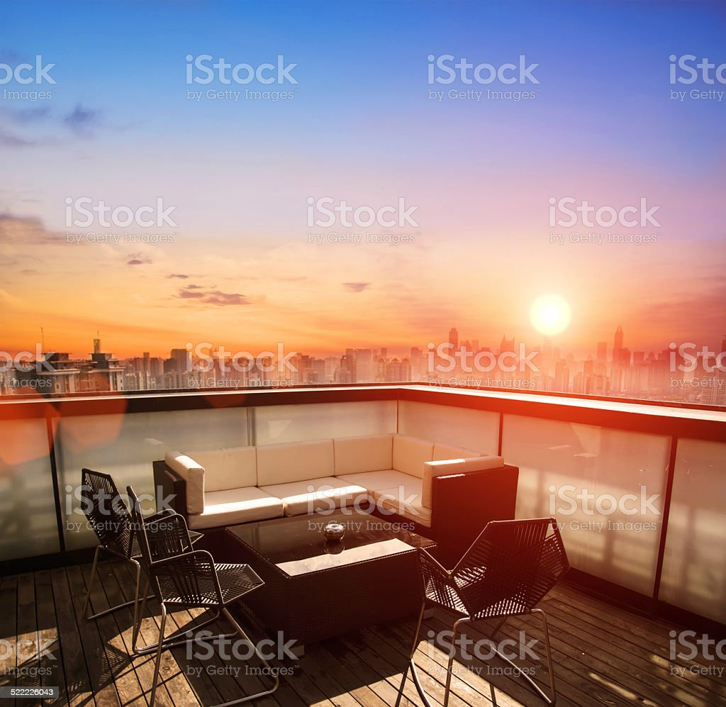 rooftop restaurant look at modern city landscape the sunset stock photo