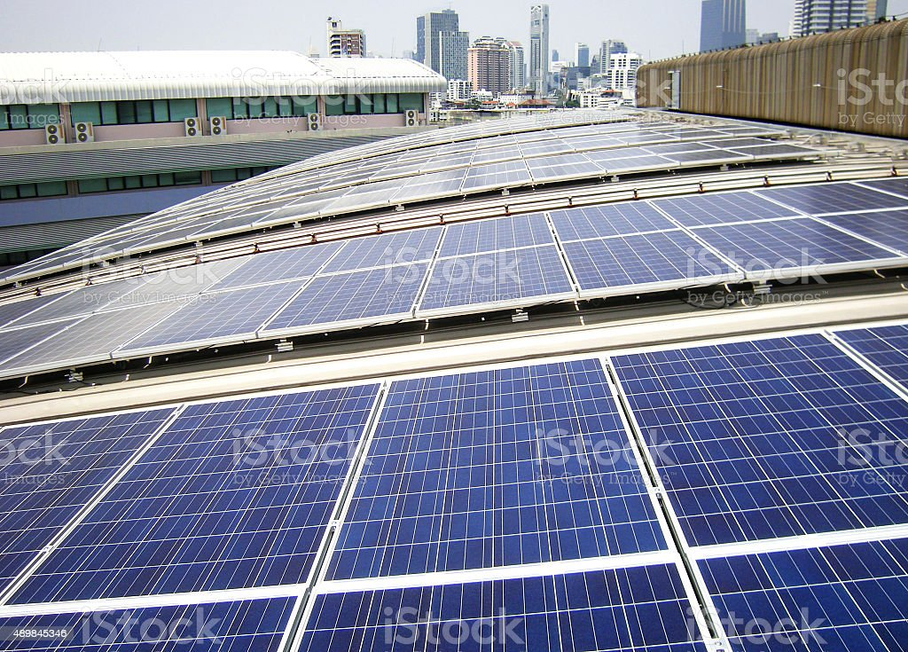 Rooftop Solar Panels on Factory Roof stock photo