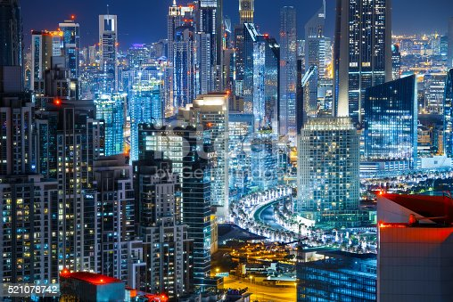 istock Rooftop view a big modern city by night. Travel background. 521078742
