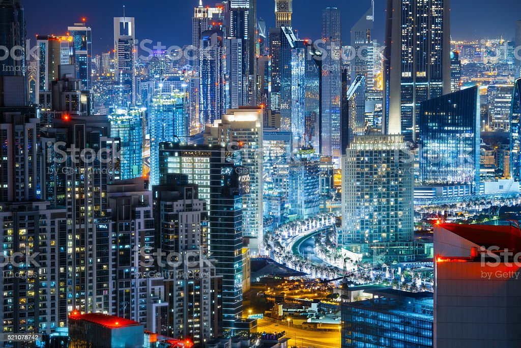 Rooftop view a big modern city by night. Travel background. stock photo