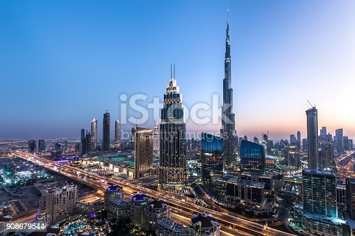Blue hour view of Dubai Downtown architecture after winter sunset. Dubai, United Arab Emirates.