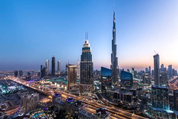 Rooftop view of Dubai Downtown after sunset. Blue hour view of Dubai Downtown architecture after winter sunset. Dubai, United Arab Emirates. burj khalifa stock pictures, royalty-free photos & images