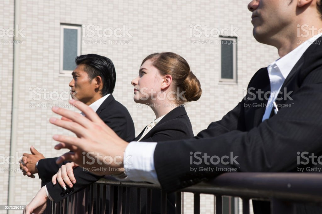 Rooftop views of downtown businesspeople stock photo