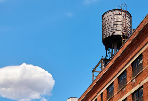 Rooftop water tank in New York City, USA. stock photo
