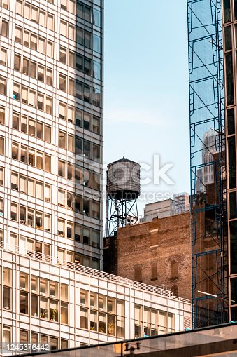 Rooftop water tower in Manhattan, New York City. This structure supplies water pressure to floors at higher elevation than public water towers.