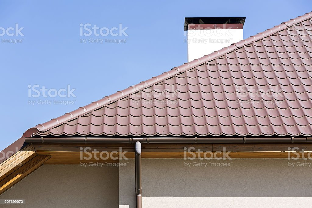 Rooftop with a rainwater drain stock photo