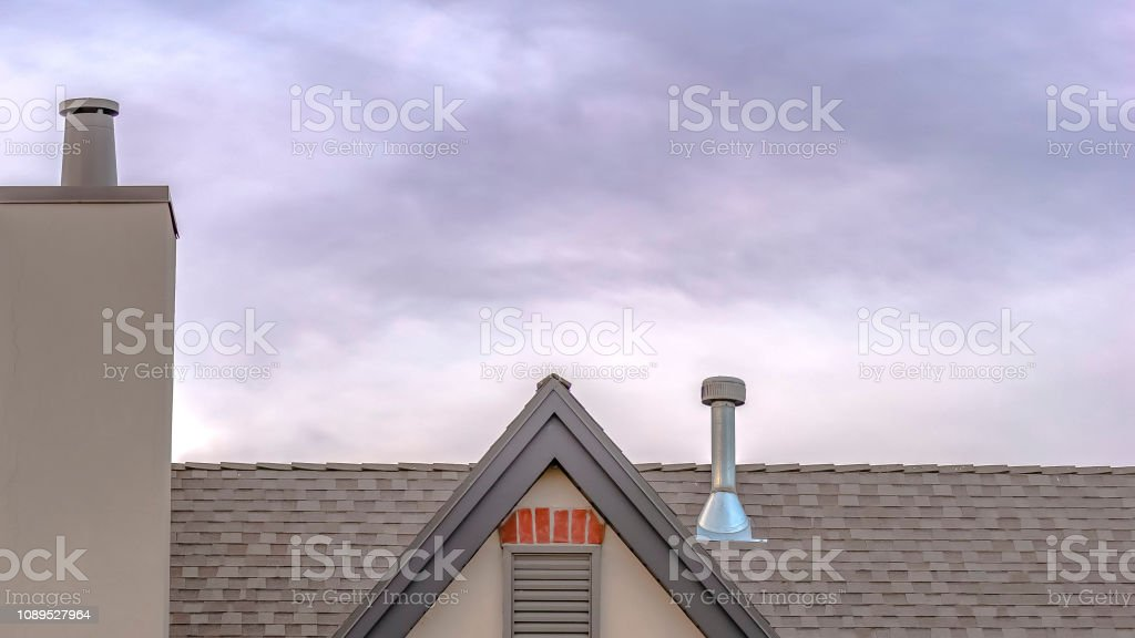 Rooftop with chimney angular roof with copy space stock photo