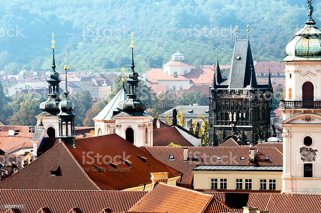 Rooftops and towers of Old Prague on a misty day stock photo