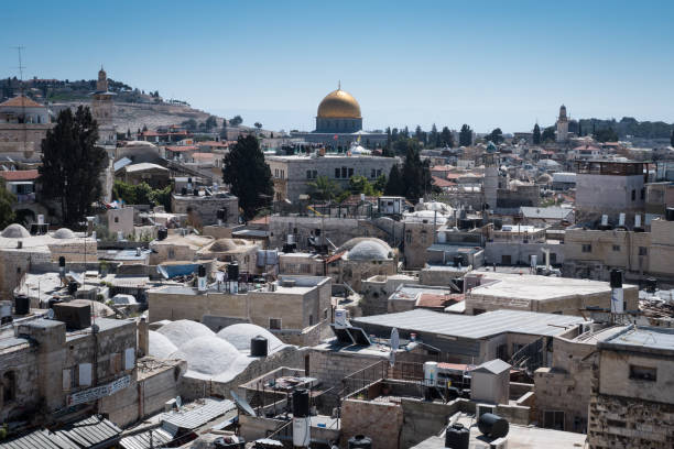 Rooftops of Jerusalem's Old City Jerusalem: Rooftops of Jerusalem's Old City with a view of the Dome of the Rock, in Israel. east jerusalem stock pictures, royalty-free photos & images