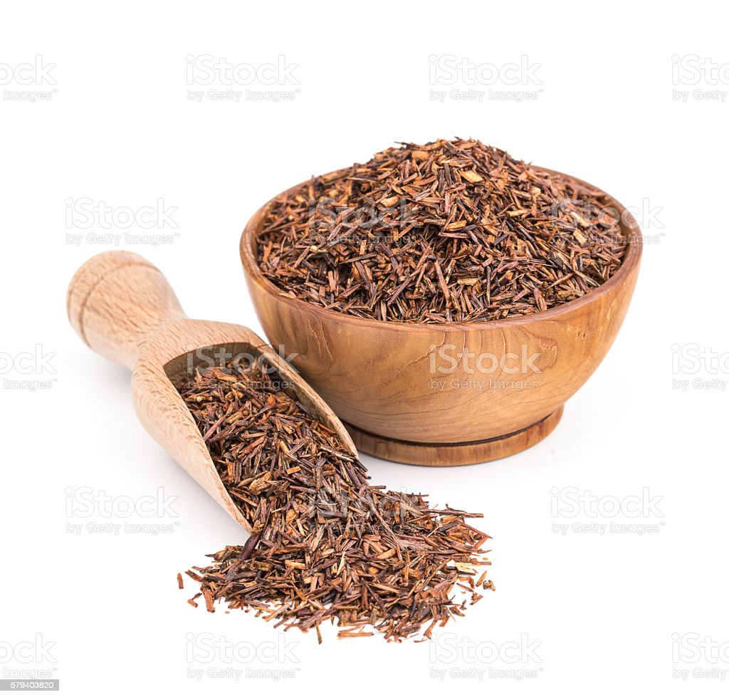 Rooibos tea in a wooden bowl isolated on white stock photo