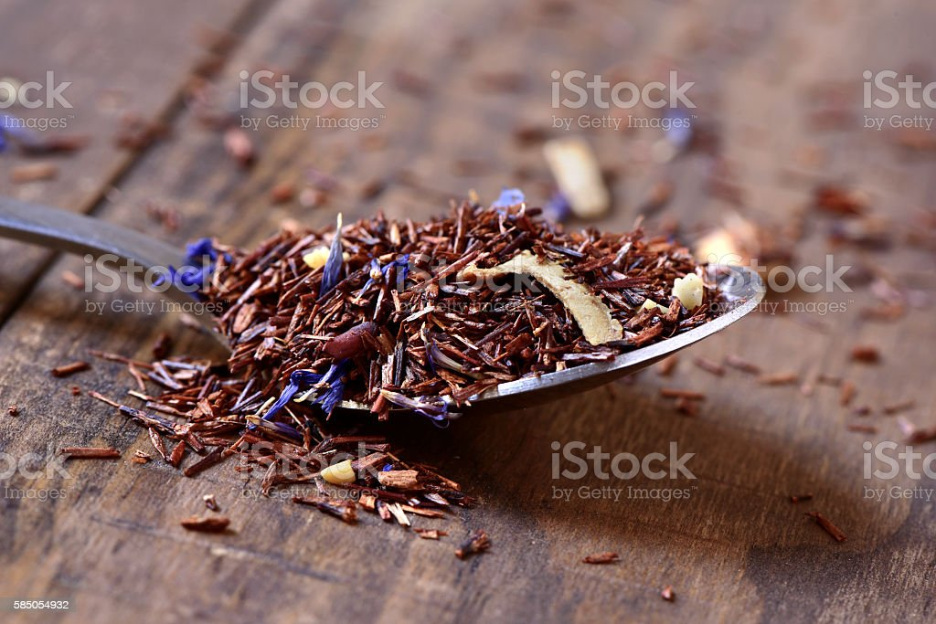 rooibos tea mixed with flowers, dry fruits and herbs stock photo