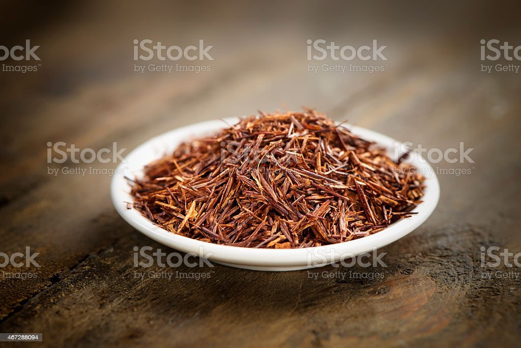 rooibos tea on a small plate stock photo