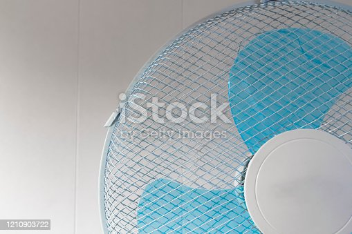 898247654 istock photo Room cooling fan 1210903722