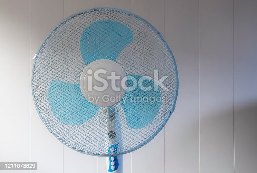898247654 istock photo Room cooling fan 1211073829