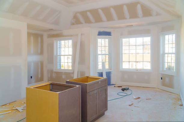 room drywalls with plasterboards at a residential building under construction Finishing putty in the room drywalls with plasterboards at a residential building under construction plaster ceiling design stock pictures, royalty-free photos & images