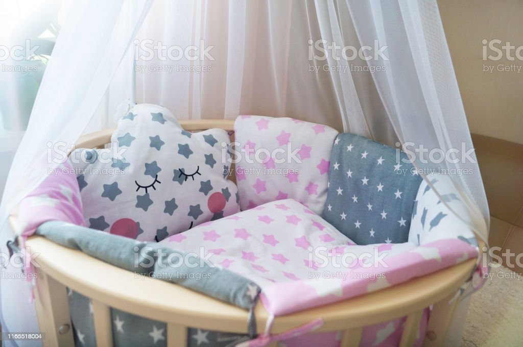 room for baby, baby round crib, white, gray, pink bedding, pillow and...