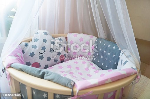 istock room for baby, baby round crib, white, gray, pink bedding, pillow and quilted blanket, pink rug bright interiors, accessories, Princess style 1165518004