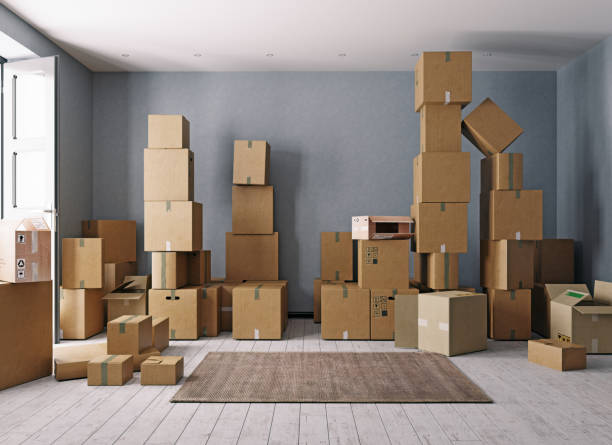 Room full of cardboard boxes stock photo