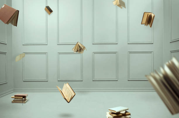 room full of flying books - on air stock photos and pictures