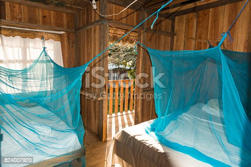 Part of simple room with two beds with moscito net. La Moskitia, Honduras