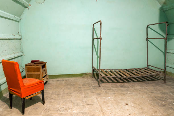 Room in the Cold War Tunnel Bedroom in the Cold War Tunnel below Gjirokaster, Albania bomb shelter stock pictures, royalty-free photos & images