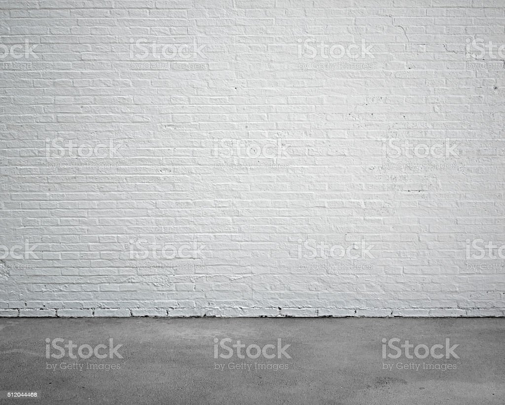 room interior with white brick wall and concrete floor stock photo
