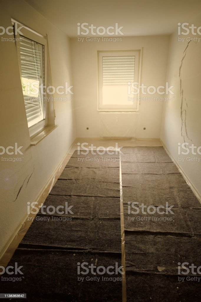 Room renovation with cracks in the wall in vertical format