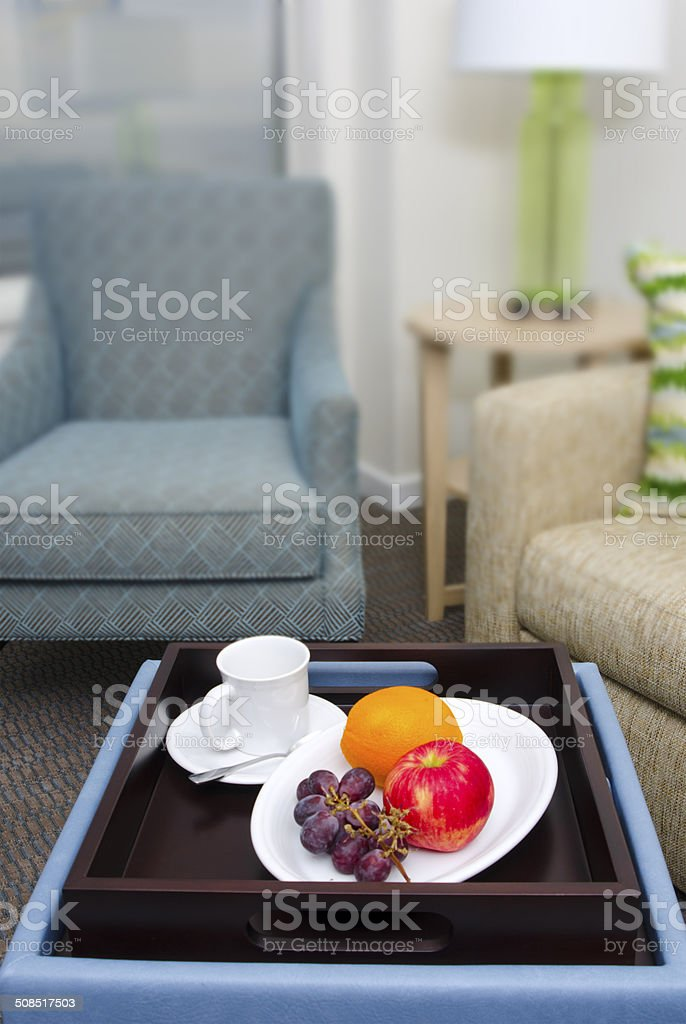 A tray of fresh fruit in a modern sitting area.