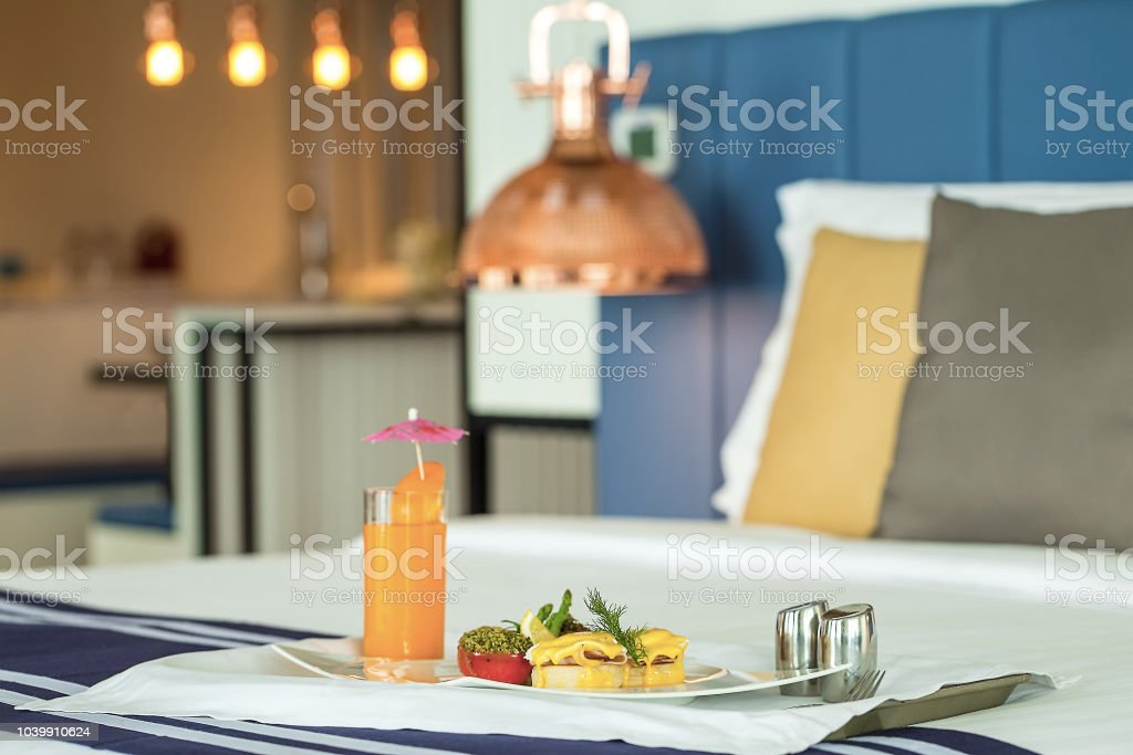 Room service serving baked bread topped with ham, braised scallops,...