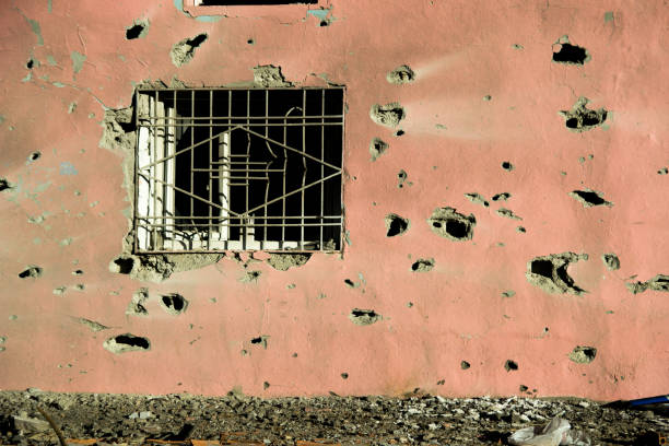 Room window with Gun Bullet-Ridle stock photo