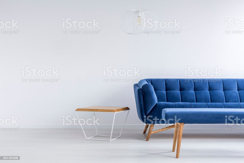 Room with blue sofa and bench stock photo