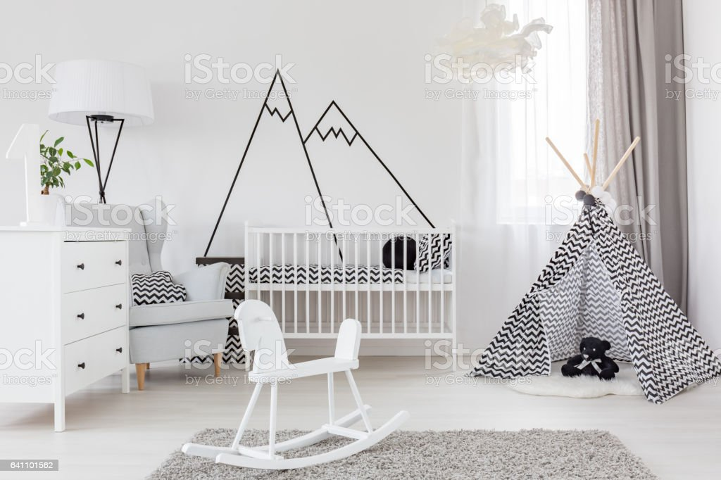 Room with cockhorse and crib stock photo