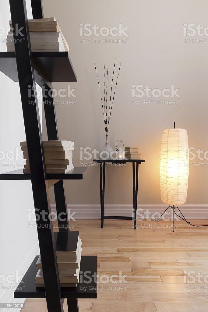 Room with contemporary decor and bookshelf stock photo