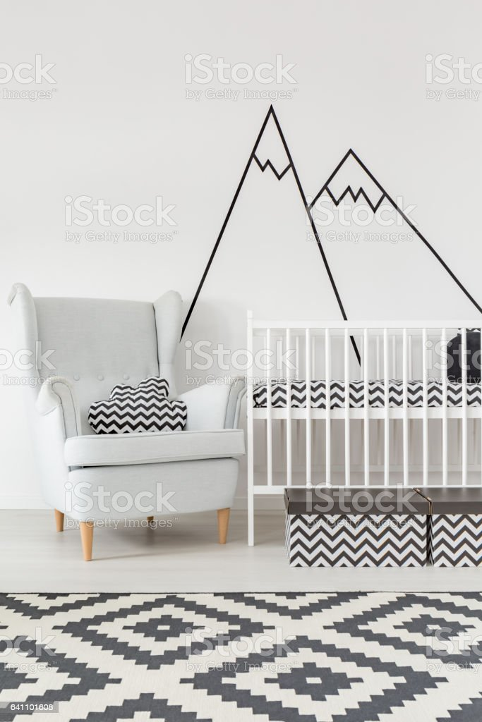 Room with cot and armchair stock photo