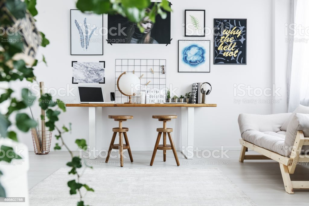 Room with desk and sofa stock photo